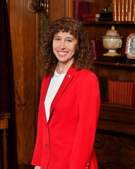 """Hahn & Hahn partner and Tournament of Roses president Laura Farber in the famous """"red jacket"""" traditionally worn by Tournament presidents"""